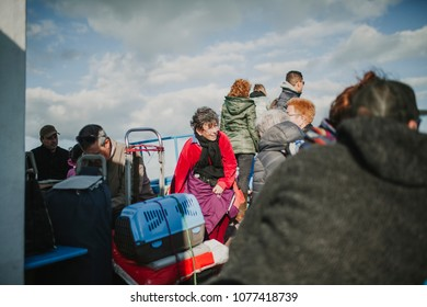 MARCH 24th, 2018 - OLHAO, PORTUGAL: Passengers enjoying the trip by boat between the Portuguese city of Olhão and the Armona Island, navigating Ria Formosa under a beautiful blue sky, on March 24th,