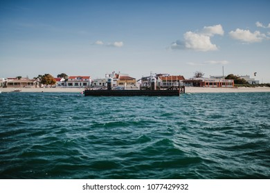 MARCH 24th, 2018 - OLHAO, PORTUGAL: Armona island pier view from the sea, during the boat trip from Olhão city, on March 24th, 2018.