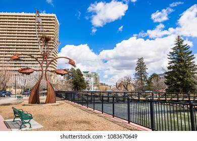 March 25, 2018 Reno / Nevada / USA - Art display and walking path on the shoreline of Truckee river, running through the city's downtown