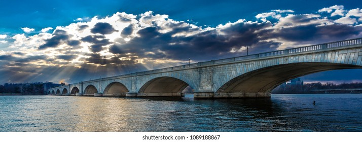 MARCH 25, 2018 - WASHINGTON D.C. - Memorial Bridge at dusk spans Potomac River at sunset