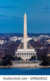 MARCH 26, 2018 - ARLINGTON, VA - WASH D.C. - Aerial view of Washington D.C. from Arlington, Virginia shows Lincoln & Washington Memorial blocking out US Capitol