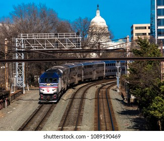 MARCH 26, 2018 - Passenger Metro train with US Capitol in background approaches L'enfant Plaza Station, Washington D.C.