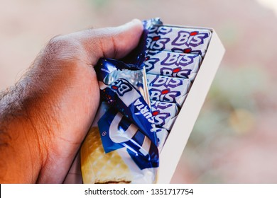 March 27, 2019, Brazil. Man safe box with several chocolates Bis. Sweet is wafer type, stuffed, topped with chocolate Lacta.