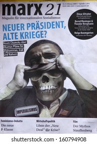 "MARCH 28, 2009 - BERLIN: magazine title showing Barack Obama ""unmasking"" a skull - protests against the banking crisis in Europe in Berlin."