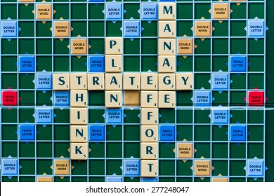 March 3, 2015 - Dhaka, Bangladesh - illustrative editorial of Scrabble tiles spelling strategy, plan,think,manage