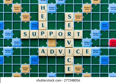 March 3, 2015 - Dhaka, Bangladesh - illustrative editorial of Scrabble tiles spelling Support help service, advice