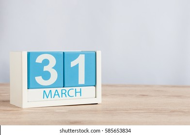 March 31st. Day 31 of month, wooden color calendar on table background. Spring time, empty space for text