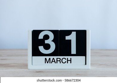 March 31st. Day 31 of month, everyday calendar on wooden table background. Spring time, empty space for text