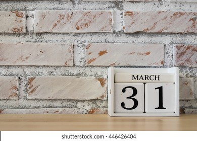 March 31st. Image of march 31 wooden color calendar on white brick wall background.  empty space for text. World Backup Day and the month end