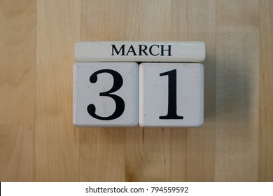 MARCH 31st. Image of MARCH 31 wooden color calendar on white wood wall background. empty space for text.