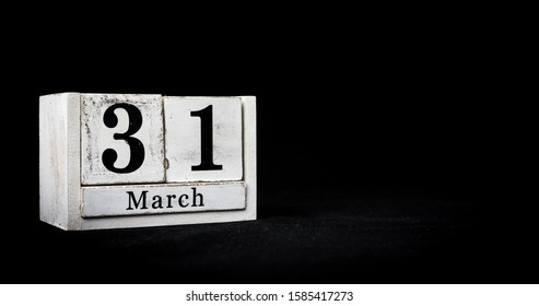 March 31st, Thirty-first of March, Day 31 of month March - white calendar blocks on black textured background with empty space for text