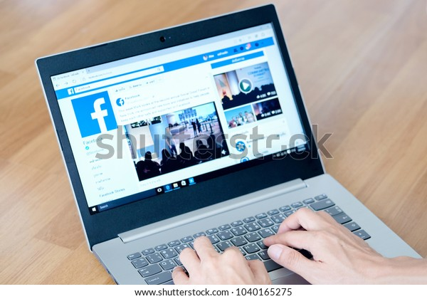 March 5, 2018 Bangkok, Thailand young men use computer laptop internet  looking screen Facebook is social networking service.he surf the Internet to get information of the world.
