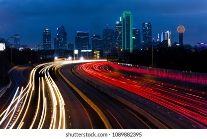 MARCH 5, 2018, DALLAS SKYLINE TEXAS, and Tom Landry Freeway, with streaked lights on Interstate 30 at night