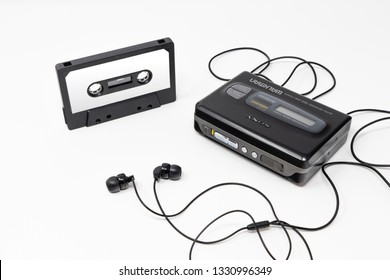 March 5, 2019 - Rome, Lazio, Italy - The original sony walkman, vintage portable cassette player, icon and symbol of the 80s and 90s. Blank audio tape and headphones isolated on white background.