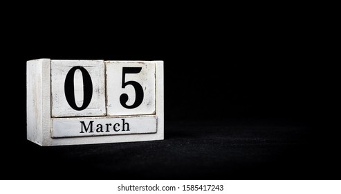 March 5th, Fifth of March, Day 5 of month March - white calendar blocks on black textured background with empty space for text