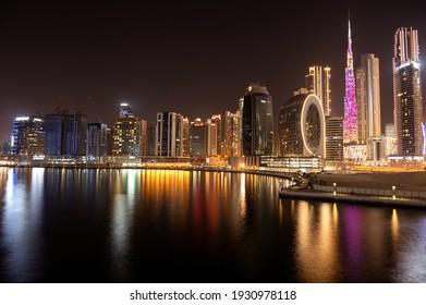 March 5th,2021, Dubai,UAE. Beautiful view of the illuminated sky scrapers along with Burj khalifa captured from the Marasi drive at the Business bay district, Dubai, UAE.