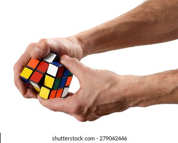 March 6, 2015, Milan, Lombardy, Italy : Man twisting a Rubik's cube puzzle with scrambled colors