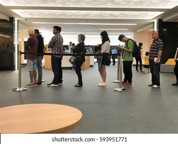 March 6, 2017, Auckland New Zealand. People standing in a queue in an ASB Bank branch. ASB was formed in 1847 as Auckland Savings Bank.