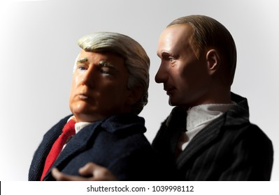 MARCH 6 2018: Caricatures of Russian President Vladimir Putin whispering suggestions of collusion into the ear of US President Donal Trump - doll action figures