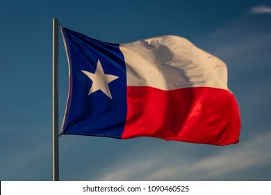 """MARCH 6, 2018 - TEXAS STATE FLAG - Texas """"Lone Star"""" flag stands out against a cloudless blue sky as it flys in a steady wind in Houston, Texas"""
