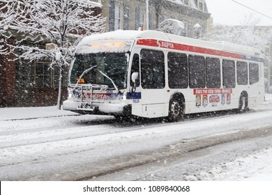 March 7, 2018 - Philadelphia, PA, USA:  A SEPTA bus travels down a snow covered street during a late winter blizzard in Philadelphia, Pennsylvania.