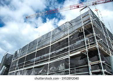 March 7, 2021. Construction progress on new building site with working crane and blue sky backdrop. New social housing residential home units development at 56-58 Beane St. Gosford. Australia.