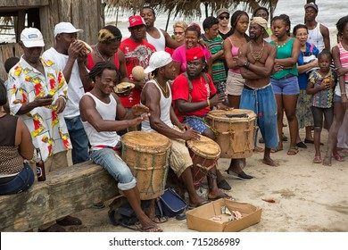 March 8, 2015 Sambo Creek, Honduras: young garifuna men playing traditional drums outdoors