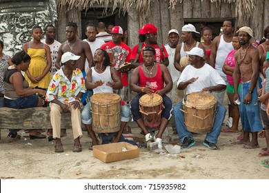 March 8, 2015 Sambo Creek, Honduras: young garifuna men playing traditional drums outdoors during a community outdoor dance event