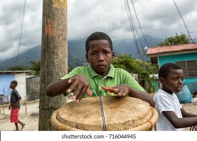 March 8, 2015 Sambo Creek, Honduras: young garifuna boy playing a traditional drum