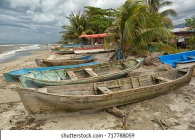 March 8, 2015 Sambo Creek, Honduras: dugout canoes on the beach by the small garifuna fishing village