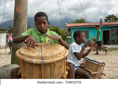March 8, 2015 Sambo Creek, Honduras: young garifuna boys playing traditional drums outdoors
