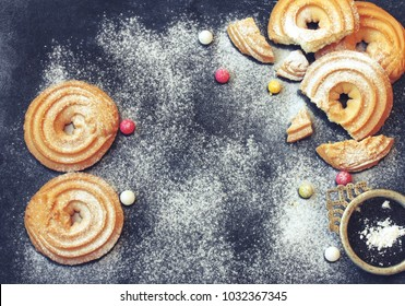 March 8, International Women's Day, homemade cookies sprinkled with sugar powder, candy pills on a black table