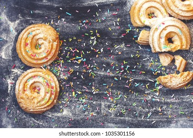 March 8, International Women's Day, homemade cookies dusted with icing sugar, sprinkling colored on black table