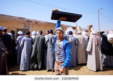 March 9, 2018-Cairo, Egypt: A man is selling foods at the camel sales market in Cairo, Egypt
