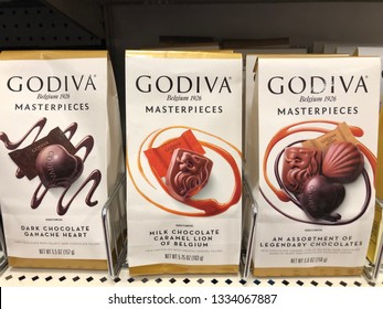 March 9, 2019 - Crystal MN: Packages of Godiva chocolate on sale at a grocery store. Varieties include Belgium Chocolate, Milk and Dark Chocolate. This candy is considered a premium gourmet brand.