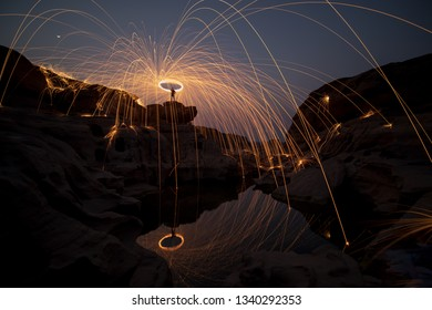 March 9, 2019 Sam Pan Bok , Ubolratchathani province, Thailand  man fling the lights, an exciting experience for photography.
