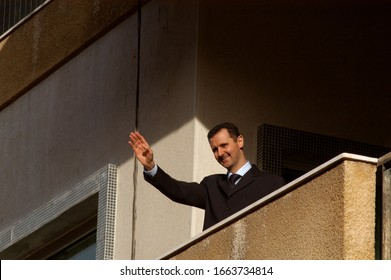 March 9th 2005 Damascus, Syria.The Syrian President Bashar al Assad waves to his supporters during a pro government demonstration in the center of Damascus, Syria.