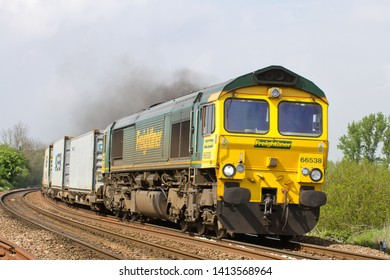 MARCH, CAMBRIDGESHIRE, UK - APRIL 30, 2014: In a cloud of exhaust Freightliner Class 66 No. 66538 rounds the curve out of March in charge of the 4L85 12:28 Doncaster Europort to Felixstowe intermodal