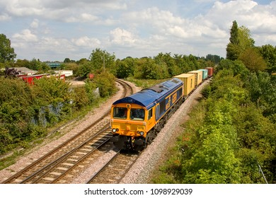 MARCH, CAMBRIDGESHIRE, UK -AUGUST 5, 2011: Having just passed March Yard, GBRf Class 66 No. 66737 'Lesia' hauls the 4E33 Felixstowe to Doncaster Railport Intermodal service west out of March.