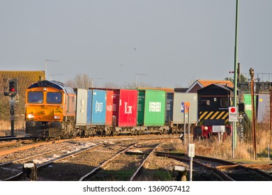 MARCH, CAMBRIDGESHIRE, UK - JANUARY 23, 2014: GBRf Class 66 No. 66732 GBRf The First Decade 1999 - 2009 John Smith MD rounds the curve at March East Junction with a Felixstowe to Doncaster intermodal.
