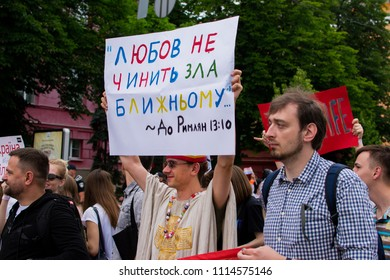 March of equality KyivPride. Kiev, Ukraine. 17 june 2018.  Transgender, gay, lesbian and community in the parade. Young guys and girls with LGBT flags. Procession with rainbow flags on Pride week.