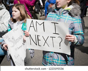 March For Our Lives: Close up of a young girl holding a sign that asks Am I Next during the march to end gun violence on 6th Ave, NEW YORK MAR 24 2018.
