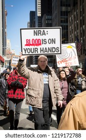 March For Our Lives: A man holds a sign that says NRA Blood Is On Your Hands during the march to end gun violence on 6th Ave, NEW YORK MAR 24 2018.