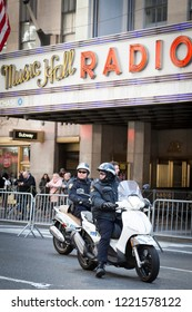 March For Our Lives: NYPD officers on motorcycles ride by Radio City Music Hall just before the march to end gun violence on 6th Ave, NEW YORK MAR 24 2018.