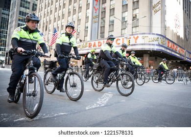 March For Our Lives: NYPD officers on bicycles ride by the front of Radio City Music Hall before the march to end gun violence on 6th Ave, NEW YORK MAR 24 2018.