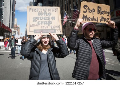 March For Our Lives: Participants in the march to end gun violence on 6th Ave hold signs with various phrases including Stop Blaming Mental Illness, NEW YORK MAR 24 2018.