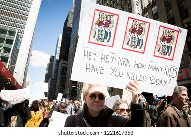 March For Our Lives: Participants in the march to end gun violence hold signs with various phrases including Hey Hey NRA How Many Kids Have You Killed Today, on 6th Ave, NEW YORK MAR 24 2018.