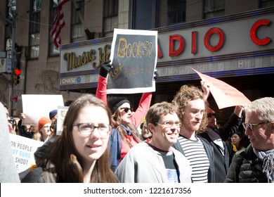 March For Our Lives: Participants in the march to end gun violence hold signs with various phrases including Books Not Bullets, on 6th Ave, NEW YORK MAR 24 2018.