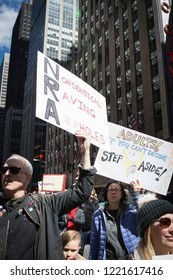 March For Our Lives: Participants in the march to end gun violence hold signs with various phrases including Nonsensical Raving Assholes, on 6th Ave, NEW YORK MAR 24 2018.