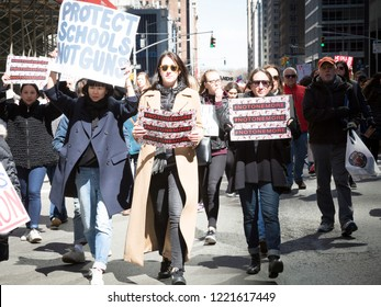 March For Our Lives: Participants in the march to end gun violence hold signs with various phrases including Protect Schools Not Guns, on 6th Ave, NEW YORK MAR 24 2018.